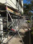 Aluminium Scaffold towers linked together to provide level work area for repairs - Canterbury