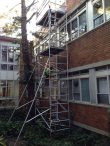 Aluminium scaffold tower installed for access to for the replacement or gutters and down pipes at school - Auburn